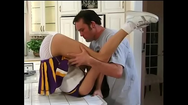 Gorgeous young cheerleader fucks in the kitchen and gets a mouthful of cum